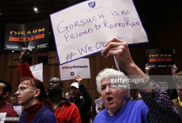 Activists participate in an antiGorsuch rally April 6 2017 on Capitol Hill in Washington DC Senate Democrats joined activists to call on the Senate...
