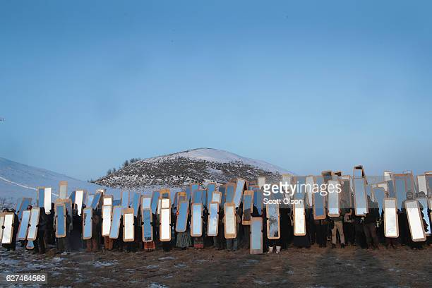 Activists participate in an art project conceived by Cannupa Hunska Luger from the Standing Rock Sioux Tribe at Oceti Sakowin Camp on the edge of the...
