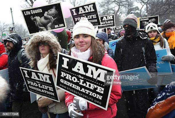 Activists participate in the 2016 March for Life January 22 2016 in Washington DC The annual event marked the anniversary of the Supreme Court Roe v...