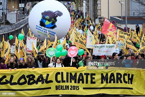 Activists participate in the Global Climate March on November 29 2015 in Berlin Germany The COP21 2015 Paris Climate Conference will begin on...