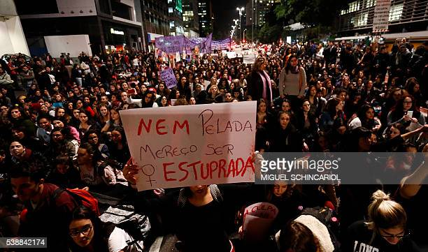 Activists protest against a gangrape of a 16yearold girl occured two weeks ago along Paulista Avenue in Sao Paulo Brazil on June 8 2016 The Brazilian...