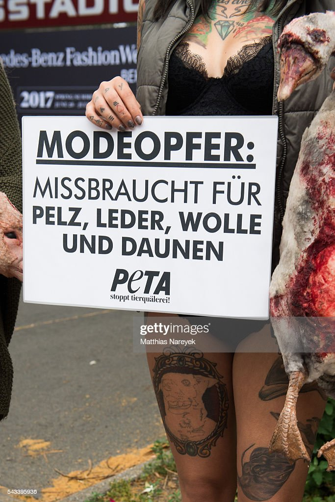 PETA activists protest against animal suffering in the fashion industry during the Mercedes-Benz Fashion Week Berlin Spring/Summer 2017 on June 28, 2016 in Berlin, Germany.