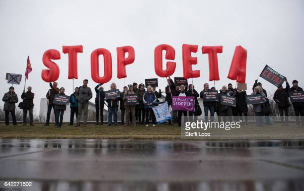 Activists protest against CETA trade agreement before a visit of Canada's Prime Minister Justin Trudeau in front of the chancellery on February 17...