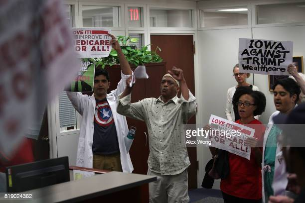 Activists protest against the Republican health care repealandreplace legislation at US Sen Chuck Grassley's office in the Hart Senate Office...