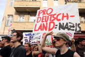 Activists protest in a counterdemonstration against the farright political party 'pro Deutschland' as the latter holds a rally across the street in...