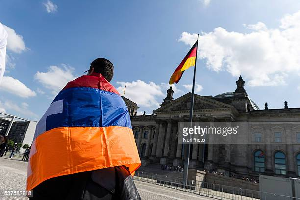 Activists protest outside the Reichstag building while the Bundestag is discussing a resolution regarding the recognition of the Armenian genocide on...