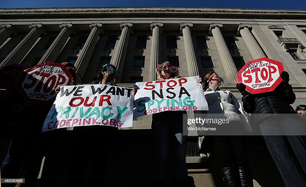 Activists protest the surveillance of US citizens by the NSA outside the Justice Department where US President Barack Obama gave a major speech on...