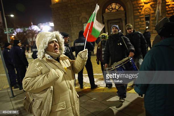 Activists protesting against the government chant slogans and wave Bulgarian national flags near the Presidential Palace on December 5 2013 in Sofia...