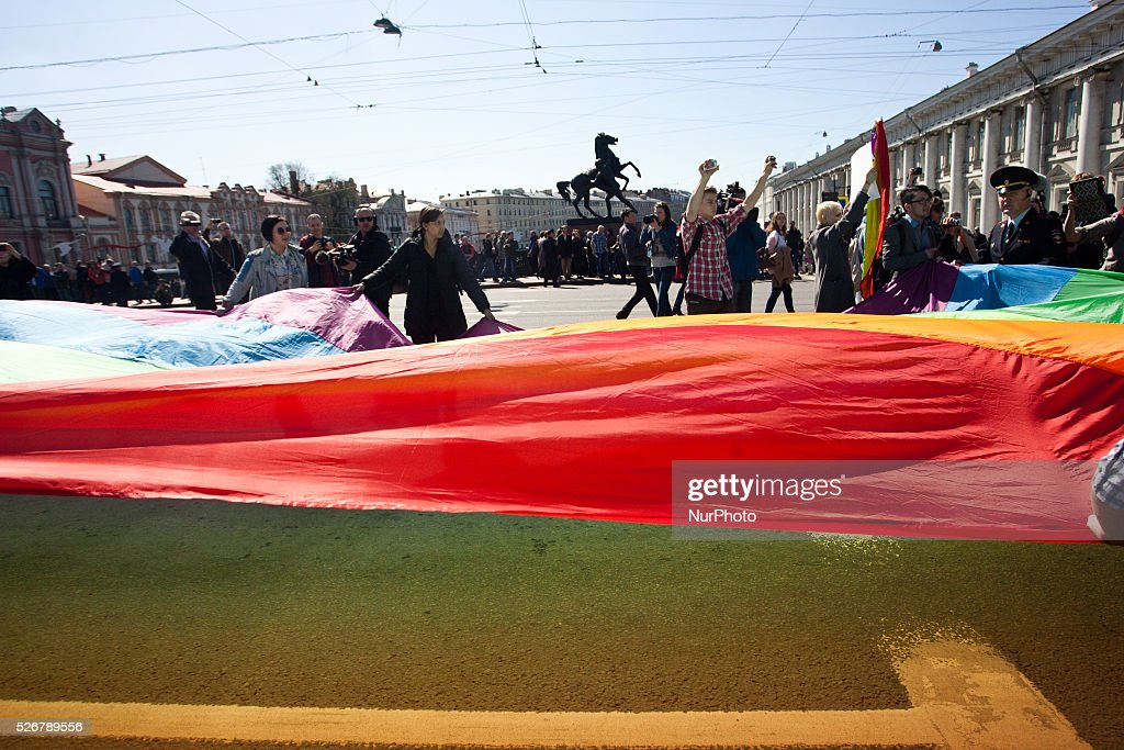 Activists raise a rainbow flag during a May Day demonstration in Saint Petersburg, Russia, 01 may 2016