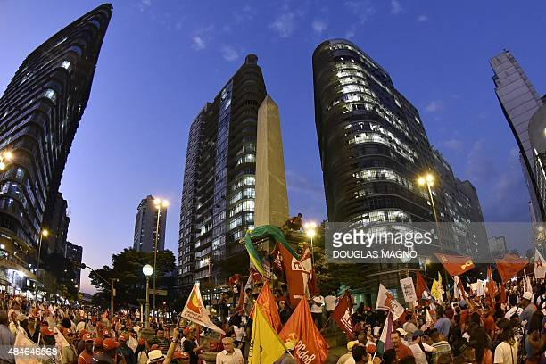 Activists rally during a demonstration called by the ruling Workers Party in Belo Horizonte Brazil on August 20 2015 The president's Workers' Party...