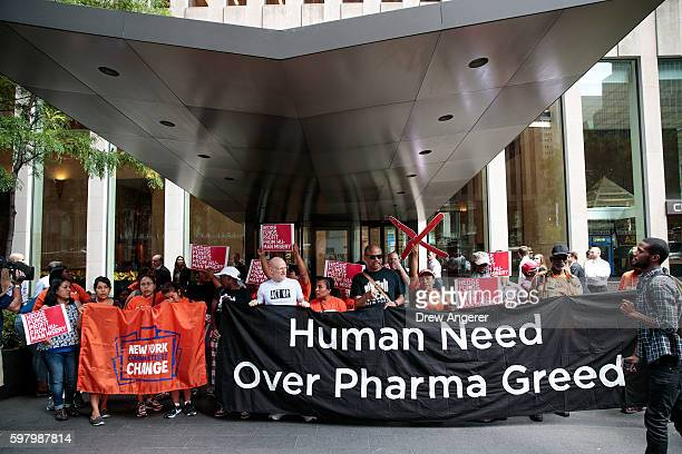 Activists rally during a protest against the price of EpiPens outside the office of hedge fund manager John Paulson August 30 2016 in New York City...