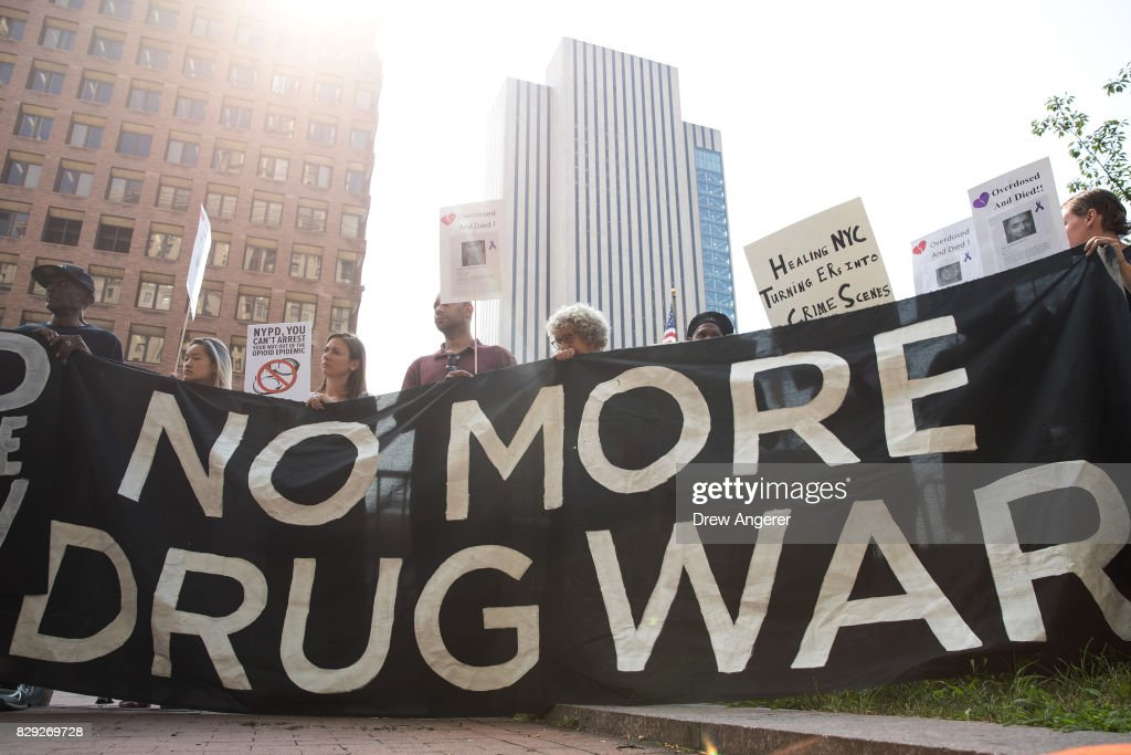 Activists rally during a protest denouncing the city's 'inadequate and wrongheaded response' to the overdose crisis, outside of the New York City Police Department (NYPD) headquarters, August 10, 2017 in New York City. The group is calling for a more public health focused approach and wants the 70 million dollars allocated to the city and NYPD's 'Healing NYC' program to be redirected to the Department Of Health and Mental Hygiene.