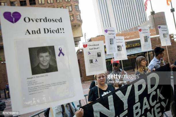 Activists rally during a protest denouncing the city's 'inadequate and wrongheaded response' to the overdose crisis outside of the New York City...
