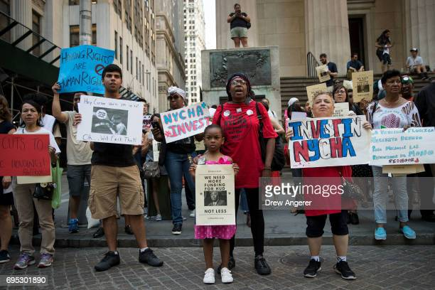 Activists rally for affordable housing and against US Secretary of Housing and Urban Development Ben Carson during his appearance at the New York...