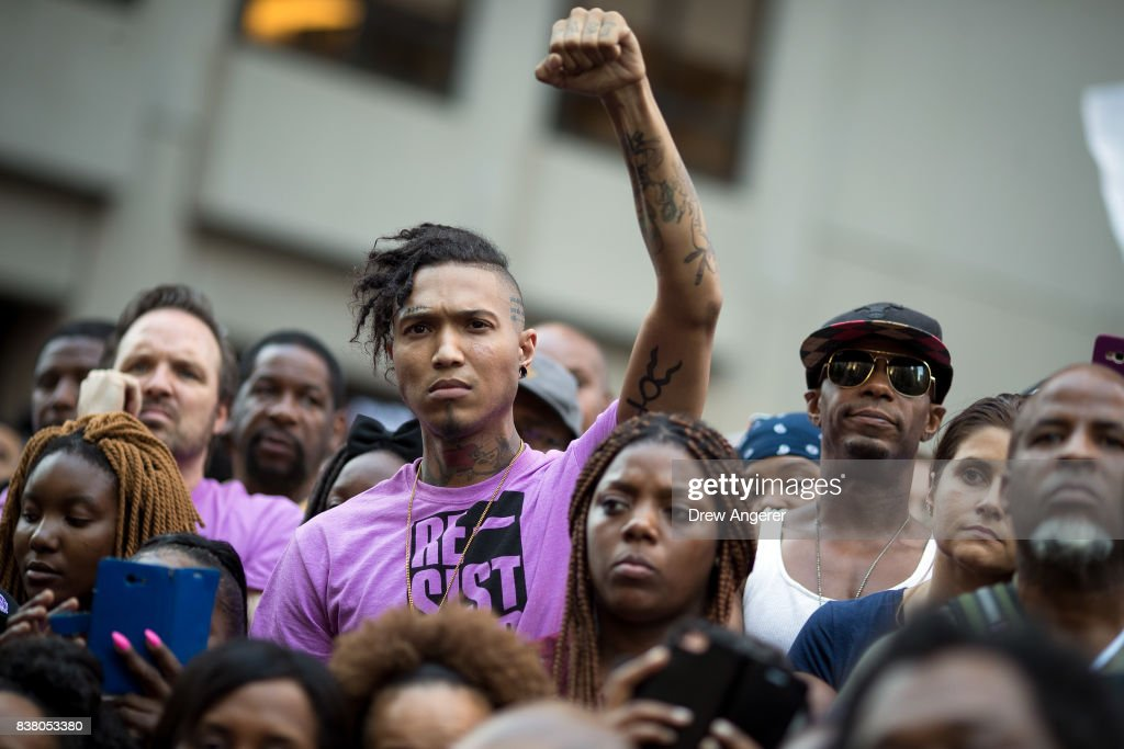 Activists rally in support of NFL quarterback Colin Kaepernick outside the offices of the National Football League on Park Avenue, August 23, 2017 in New York City. During the NFL season last year, Kaepernick caused controversy by kneeling during the National Anthem at games to protest racial oppression and police brutality. Kaepernick is currently a free agent and some critics and analysts claim NFL teams don't want to sign him due to his public display of his political beliefs.