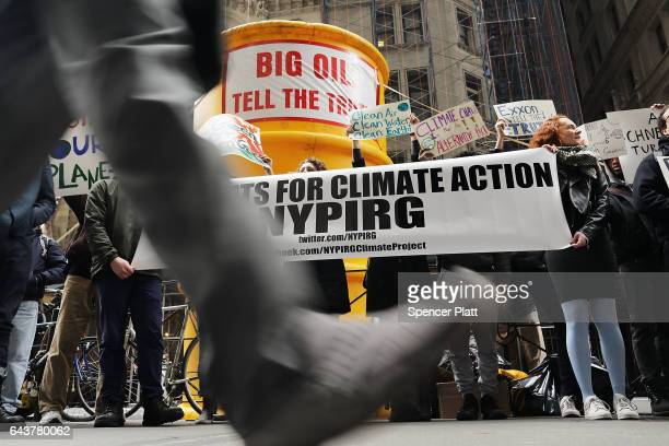 Activists rally outside of State Attorney General Eric Schneiderman's office to support the New York state investigation into whether the oil giant...