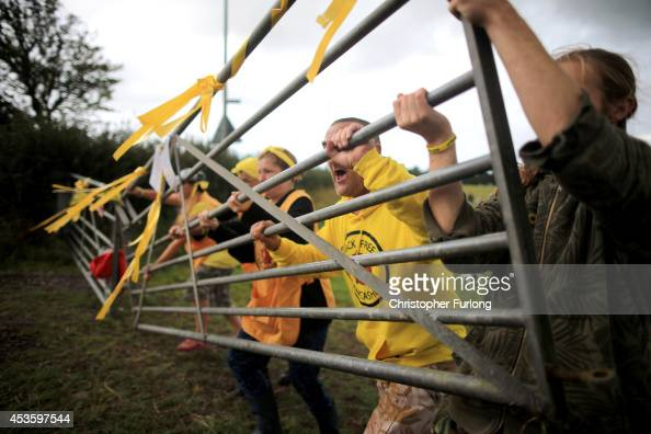 Activists rehearse the blocking of a field entrance at an antifracking camp near the site of a proposed drilling rig at Preston New Road Site near...