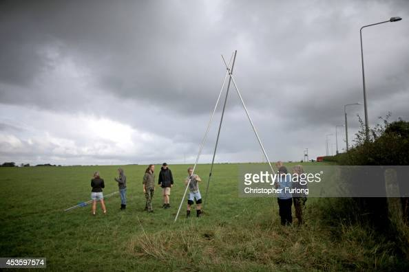 Activists rehearse the erecting of an A frame which protesters will climbed by to block access to an area of land at an antifracking camp near the...