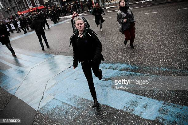Activists run as police forces draw their batons in an attempt to suppress the counter protest Clashes between antiislamist protesters and...