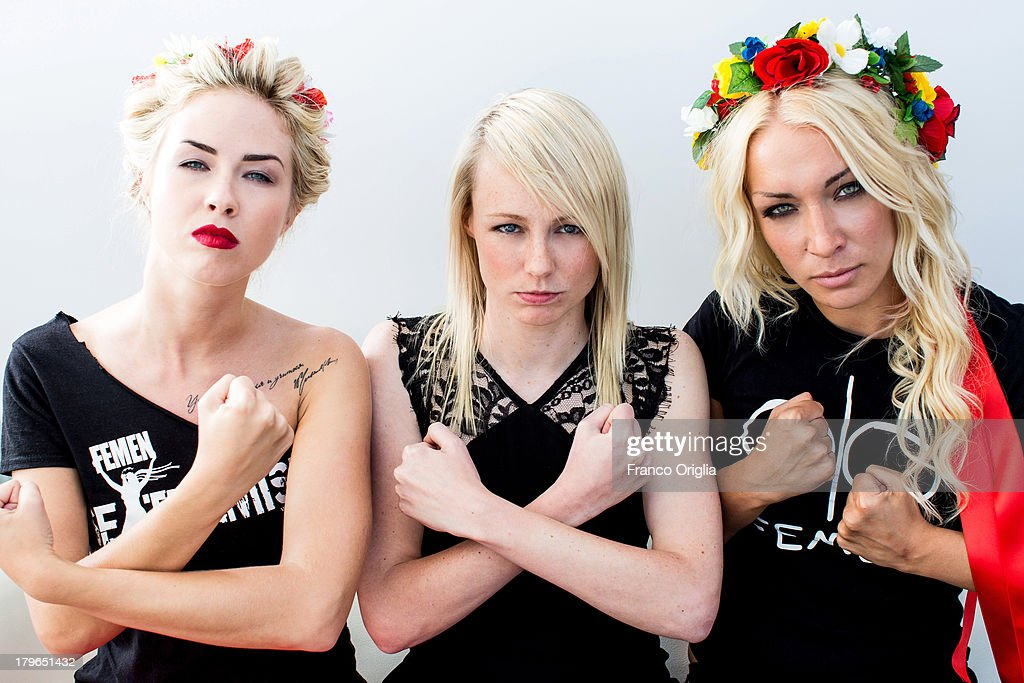 FEMEN activists Sasha Shevchenko (L) and <a gi-track='captionPersonalityLinkClicked' href=/galleries/search?phrase=Inna+Shevchenko&family=editorial&specificpeople=7249613 ng-click='$event.stopPropagation()'>Inna Shevchenko</a> (R) pose with director <a gi-track='captionPersonalityLinkClicked' href=/galleries/search?phrase=Kitty+Green&family=editorial&specificpeople=11330816 ng-click='$event.stopPropagation()'>Kitty Green</a> (C) during the 'Femen' Portrait Session for the film 'Ukraine Is Not A Brothel' as part of the 70th Venice International Film Festival on September 4, 2013 in Venice, Italy.
