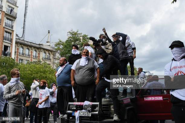 Activists shout slogans as they take part in a protest during the nationwide strike called by various French unions against proposed labour law...
