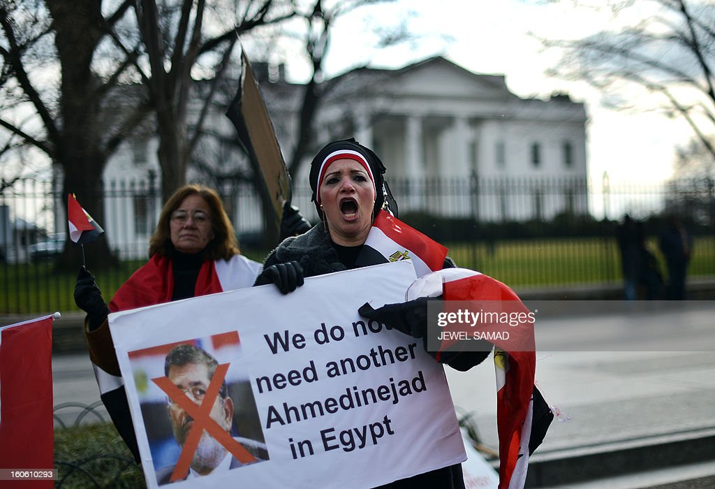 Activists shout slogans demanding the ouster of Egypt's Islamist President Mohamed Morsi during a demonstration in front of the White House in Washington on February 3, 2013. Sporadic clashes broke out overnight between protesters demanding the ouster of Morsi and security forces outside the presidential palace in Cairo on February 3. Since the start of the new wave of violence on January 24, the eve of the second anniversary of the country's 2011 uprising, nearly 60 people have been killed. AFP PHOTO/Jewel Samad