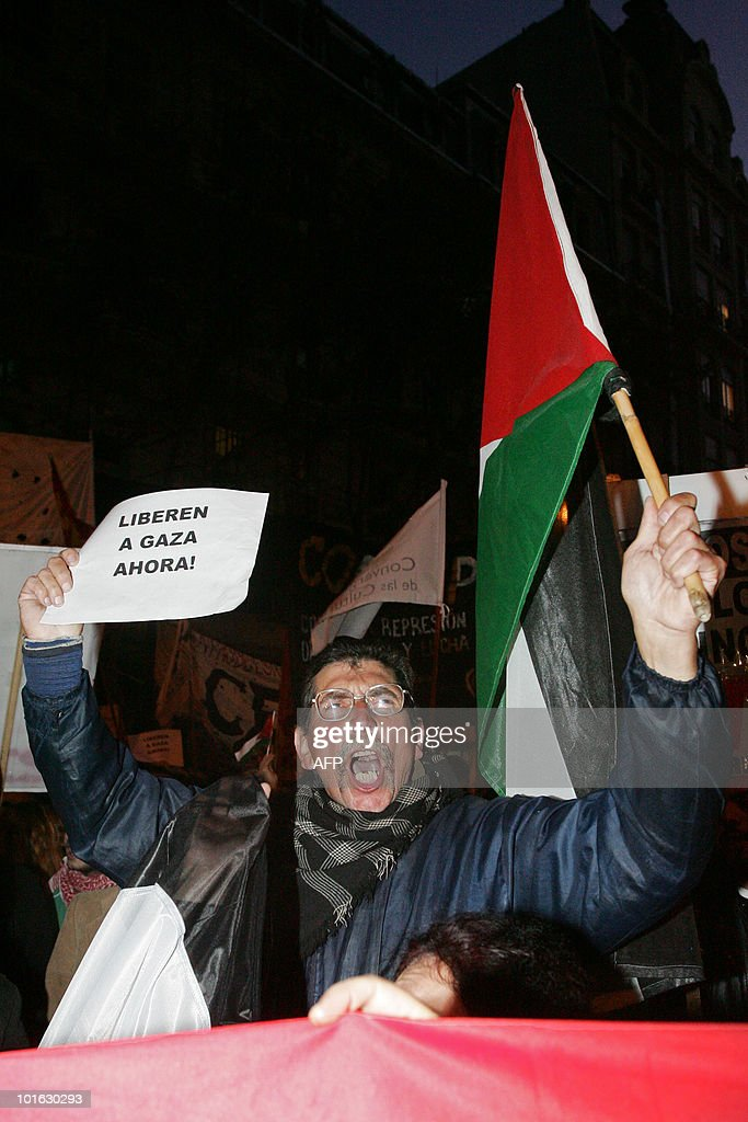 Activists shout slogans during a demonstration in support of Palestine, on June 4, 2010 at Buenos Aires. Earlier this week the Freedom Flotilla, a fleet of ships with international humanitarian aid for the Palestinians in the Gaza Strip, was raided by the Israeli army. Nine activists were killed and several more were injured. AFP PHOTO/ Maxi Failla