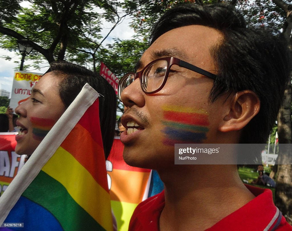 Activists shout slogans during a LGBT pride event at Rizal Park in Manila on Saturday, 25 June 2016. Hundreds of supporters and members of the lesbian, gay, bisexual, and transgender (LGBT) community paraded in Manila calling for the passage of an anti-discrimination law, as well as calling for justice for the shooting in a gay club in Orlando that left 53 people dead.
