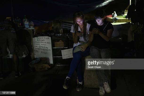 Activists sit in the kitchen at a makeshift tent camp at Marshall Park home for protesters during the Democratic National Convention September 5 2012...