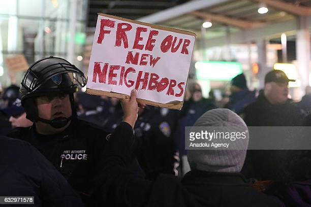 Activists stage a rally against President Donald Trump's 90days ban of entry on 7 Muslimmajority countries in the Fourth terminal of JFK airport in...