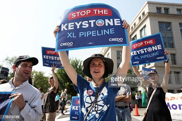 Activists stage a sitin and protest against the Keystone XL pipeline outside the US State Department August 12 2013 in Washington DC Activists from...