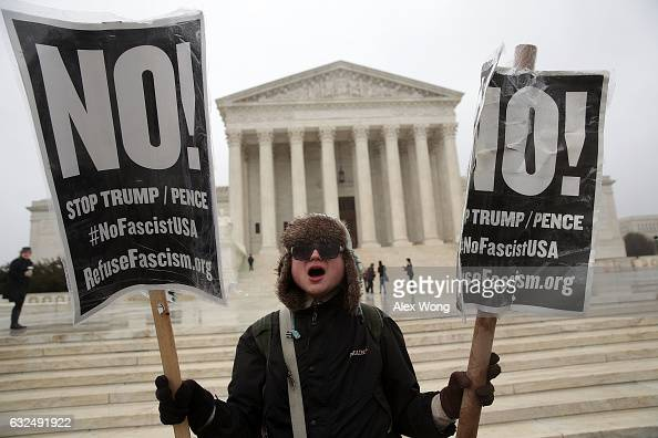 Activists stage an antiTrump protest in front of the US Supreme Court January 23 2017 in Washington DC The group Refuse Fascism called for a 'must...