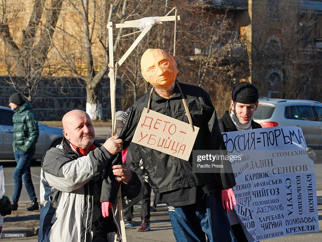 Activists stand with a mannequin depicting President of Russia Vladimir Putin,during a rally against political repression in Russia, in front the Embassy of Russia. Protesters gathered to support for political prisoners in Russia and Russian oppositionist Ildar Dadin.