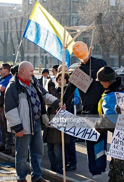 Activists stand with a mannequin depicting President of Russia Vladimir Putinduring a rally against political repression in Russia in front the...
