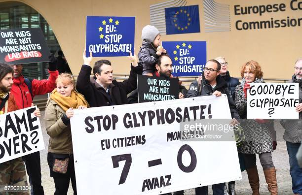 Activists stand with banners and placards in front of the European Commission in Brussels on November 9 after EU countries failed to agree to extend...