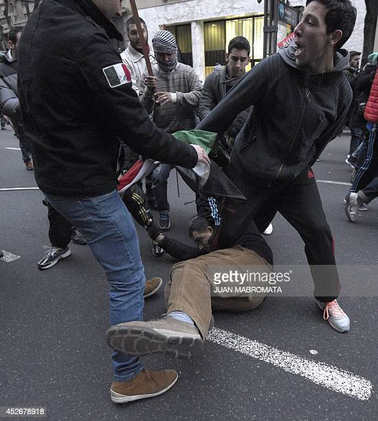 Activists struggle during a protest demanding to Israel to stop the 'genocide' in the Gaza strip outside the Israeli embassy in Buenos Aires on July...