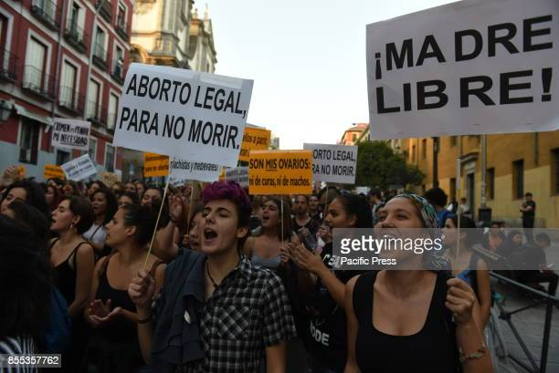 Activists take part in a demonstration to protest violence against women and in favor of the decriminalization of the abortion in Madrid
