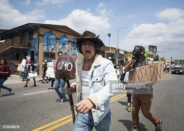 Activists take part in a march against US agrochemical giant Monsanto and GMO food products May 23 in Los Angeles California Thousands of people hit...