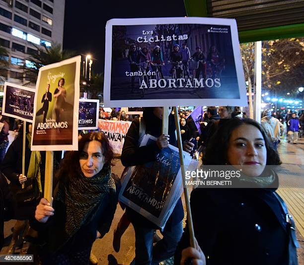 Activists take part in a proabortion protest in Santiago on July 25 2014 Thousands of people gathered in Santiago Friday to demonstrate they support...