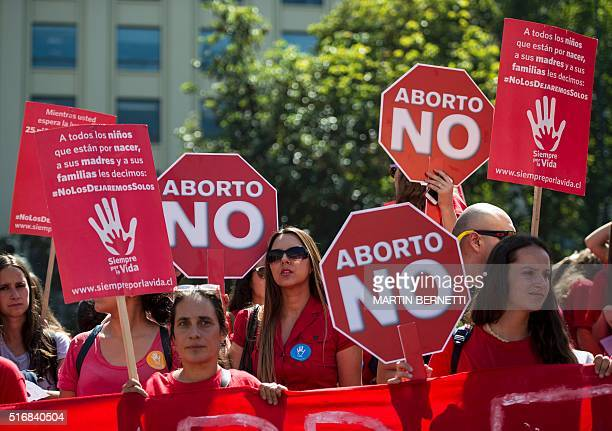 Activists take part in a protest against abortion in front of La Moneda presidential Palace in Santiago on March 21 2016 Lawmakers in Chile's lower...