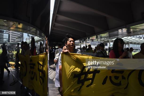 Activists take part in a protest to mark the 86th anniversary of the 'Mukden Incident' in Hong Kong on September 18 2017 The 'Mukden Incident' took...