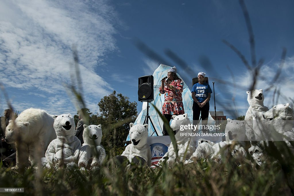 Activists talk with others dressed as polar bears during a protest in Lafayette Park September 26, 2013 in Washington, DC. Environmental activists gathered to protest the practice of arctic drilling and pressure the Obama administration to do the same. AFP PHOTO/Brendan SMIALOWSKI