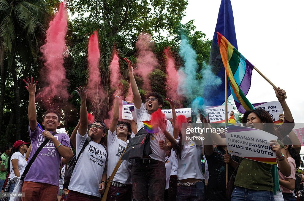 Activists throw colored powder into the air during the annual LGBT pride parade at Rizal Park in Manila on Saturday, 25 June 2016. Hundreds of supporters and members of the lesbian, gay, bisexual, and transgender (LGBT) community paraded in Manila calling for the passage of an anti-discrimination law, as well as calling for justice for the shooting in a gay club in Orlando that left 53 people dead.