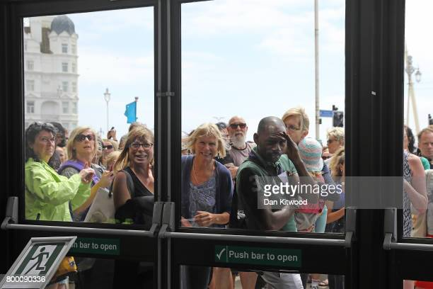 Activists wait outside the conference centre for Labour Leader Jeremy Corbyn after he addressed delegates at the Unison Conference on June 23 2017 in...