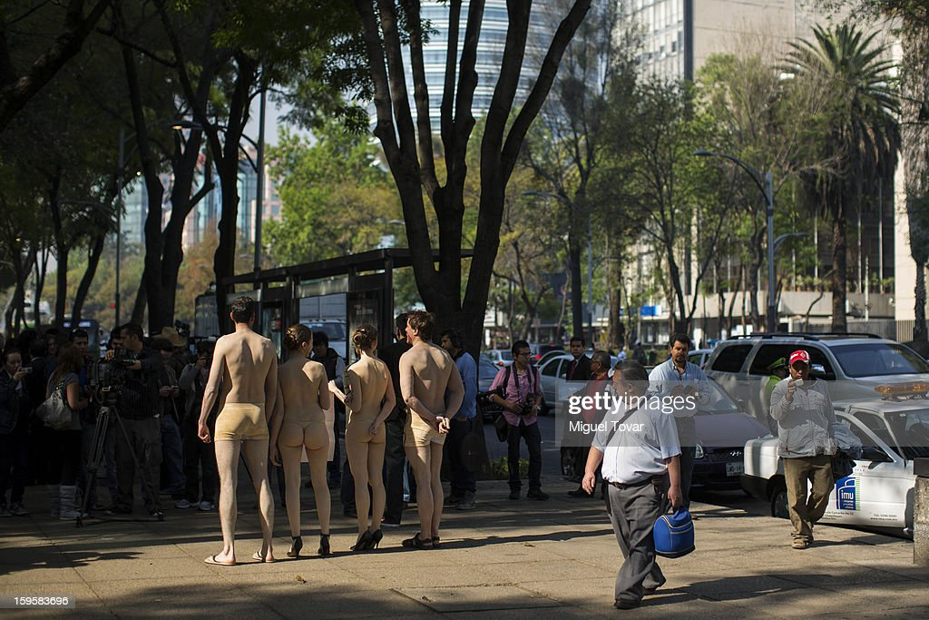 Activists wearing body paint that illustrates her organs damaged from air pollution, protesting the health effects of the city's ongoing pollution problem caused by cars and encouraging residents to use bicycles instead of cars on January 16, 2013 in Mexico City, Mexico.