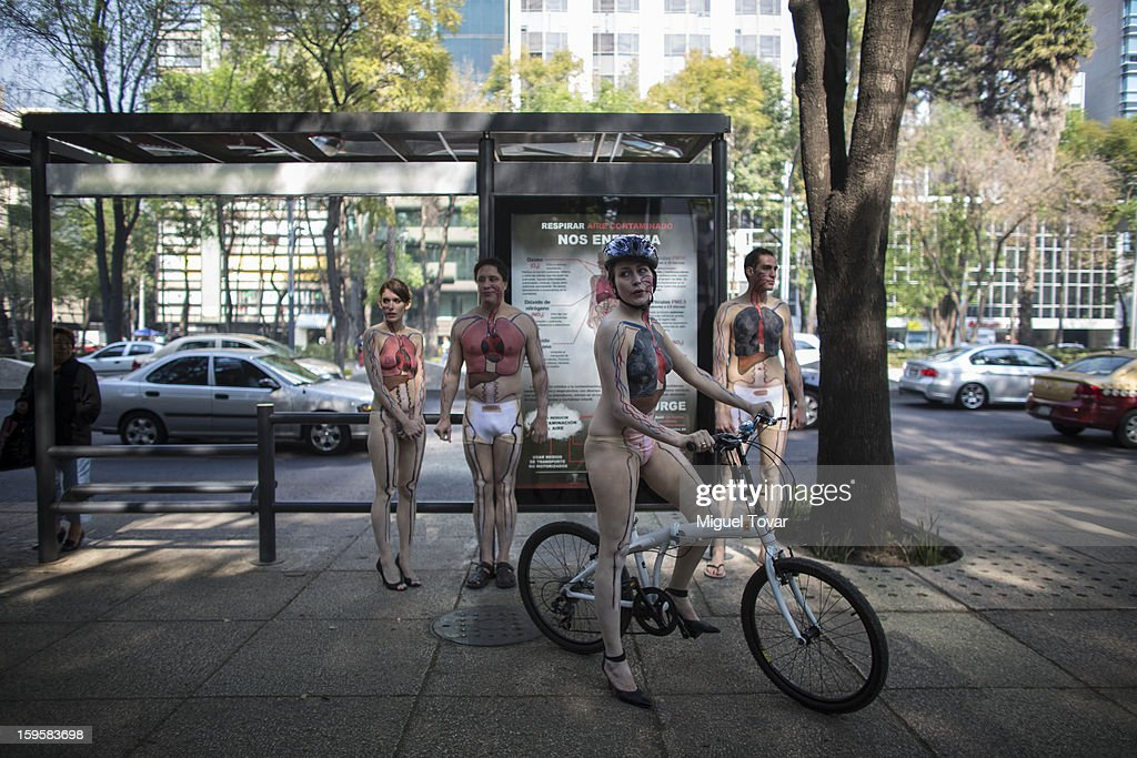 Activists wearing body paint that illustrates their organs damaged from air pollution, protest against the health effects of the city's ongoing pollution problem caused by cars and encouraging residents to use bicycles instead of cars on January 16, 2013 in Mexico City, Mexico.