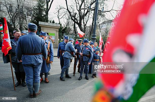 Activists wearing historic uniforms prepare for the official ceremony in front of the National Museum of Budapest on March 15 2014 during the...