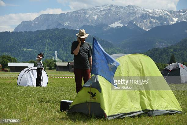 Activists who have come to protest against the nearby upcoming summit of G7 nation leaders arrive at a campsite reserved for protesters on a farmer's...