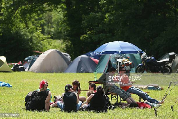 Activists who have come to protest against the nearby upcoming summit of G7 nation leaders sit among tents at a campsite reserved for protesters on a...