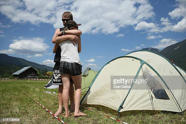 Activists who have come to protest against the nearby upcoming summit of G7 nation leaders share an embrace among tents at a campsite reserved for...